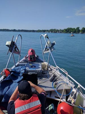 Jared Daniel, a member of the St. Clair County Sheriff Dive Team, operates a side scan sonar Tuesday. The team returned to the St. Clair River after a swimmer went missing Monday evening.