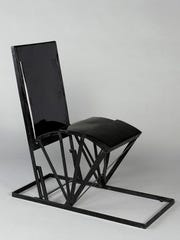 "This undated photo provided by the Jewish Museum shows Pierre Chareau's folding chair, metal and paint. The chair is part of the exhibition ""Pierre Chareau: Modern Architecture and Design,"" at The Jewish Museum in New York."