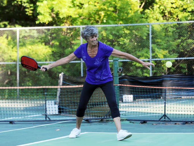 Karen Safko hits the ball during a recent pickleball game at Muirwood Village.