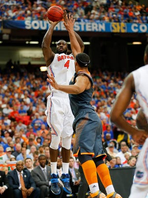 Florida's Patric Young rises to shoot over Tennessee's Jarnell Stokes.