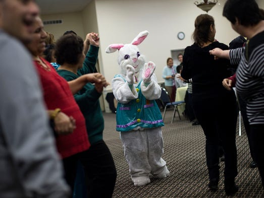 The Easter Bunny claps and dances.