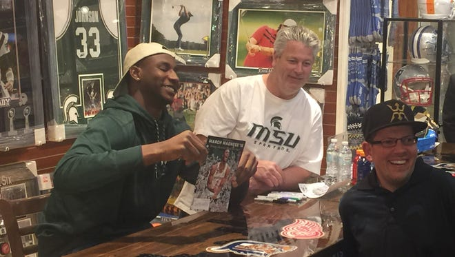 Former Michigan State star Jaren Jackson Jr. signs autographs for fans on Friday in Livonia.