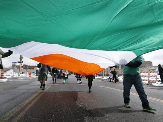 The Irish flag being carried during the St. Patrick's Day parade.