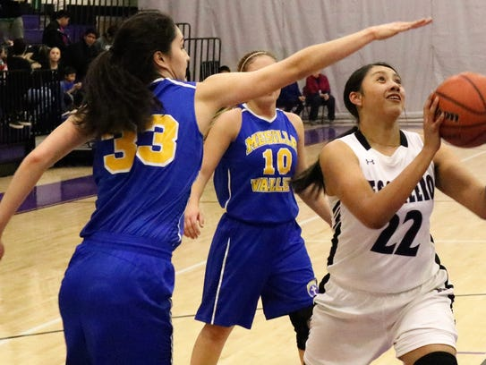 Mescalero's Justice Blake, right, attempts to score