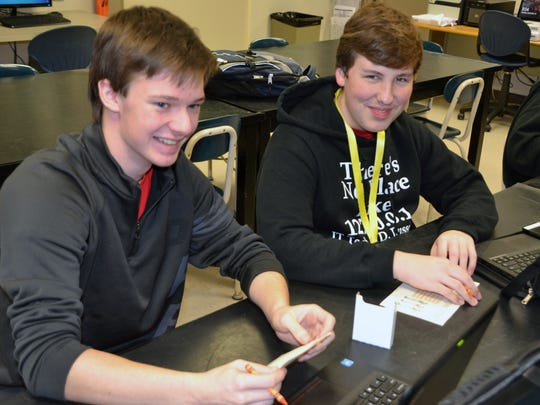 D. Russel Lee Career Technology students Damon Lyon, left, and Jacob Handermann signed holiday cards for members of the military as part of Operation Gratitude, a service project of the school's Business Professionals of America student chapter.