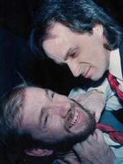 "Charlie Hukill, top, puts a chokehold on Adam Hester in ""The Dumb Waiter,"" a 1988 Abilene Christian University workshop project. The two were a pair of killers."