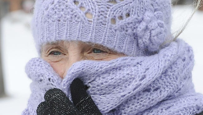 Sally Shreve braves 14-degree temperatures as she walks through Perry Square  Feb. 12 in Erie, Pa.