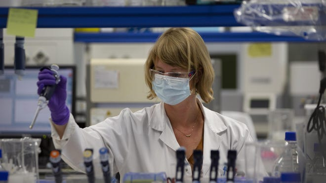 A lab technician works during research on coronavirus, COVID-19, at Johnson & Johnson subsidiary Janssen Pharmaceutical in Beerse, Belgium, Wednesday, June 17, 2020. Janssen Pharmaceutical hopes to begin clinical trials on a potential vaccine for COVID-19 in the middle of the summer.