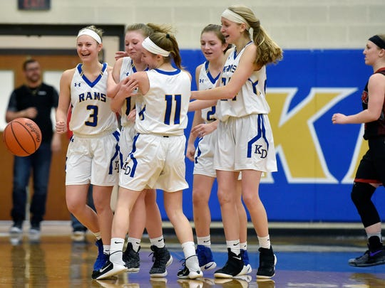 Kennard-Dale players greet Chandler Swanson, second from left, after she sank a three-point buzzer-beater to tie the game and earn an overtime period in a YAIAA girls' basketball game Friday, Jan. 19, 2018, at Kennard-Dale. Dover defeated Kennard-Dale 49-44 in overtime.