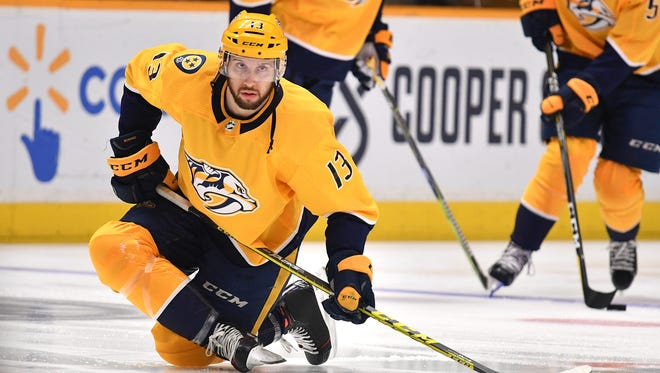 Predators center Nick Bonino (13) warms up before Game 1 of the first round NHL Stanley Cup Playoffs at Bridgestone Arena on Thursday, April 12, 2018, in Nashville.