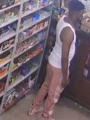 Police released this image of a suspect in the shooting death early Sunday at a Raleigh convenience store.
