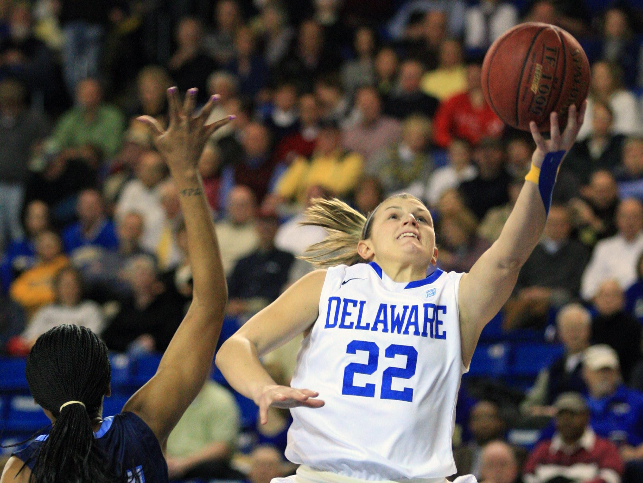 Delaware guard Lauren Carra goes to the basket for two first half points in front of Old Dominion forward Tia Lewis in the first half of Delaware's 76-63 win at the Bob Carpenter Center, Thursday Feb 9, 2012.The News Journal/William Bretzger