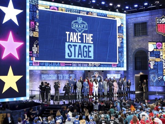 Top college prospects are seen on the stage before the first round of the NFL football draft, in Nashville, Tenn. on Thursday, April 25, 2019. (AP Photo/Gregory Payan)