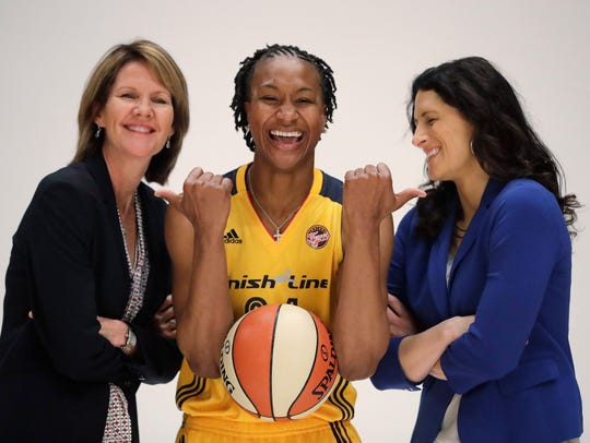 Indiana Fever's Tamika Catchings jokes with head coach