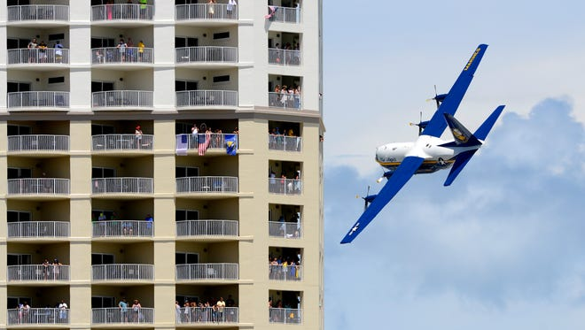The Blue Angels' C-130 cargo jet Fat Albert makes its way past spectators during the Blue Angels Pensacola Beach in 2016.