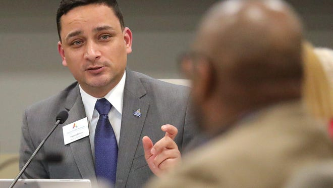 Patrick Bravo discusses Akron Public Schools closing due to the coronavirus outbreak during an APS board meeting in March.