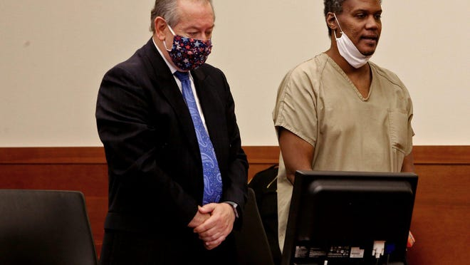 Troy Hairston, having received permission to lower his face mask, apologizes to his three victims and their families before being sentenced Thursday to the maximum of life in prison without the chance of parole. Beside him is his defense attorney, Stan Drzewiecki.