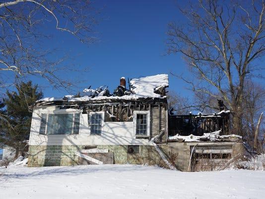 636518872190425002-zan-burnt-out-house.jpg