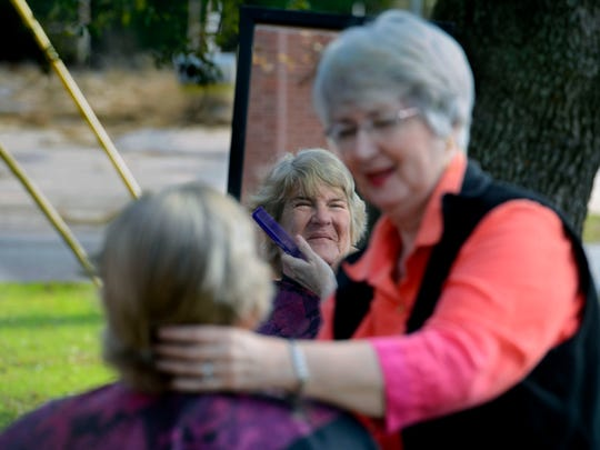 Volunteer Susan Hager gives Laura Nester a free haircut Saturday during the Keep Brownsville Warm event at Brownsville Assembly of God. Volunteers handed out free blankets, jackets, clothes and free soup along with haircuts.