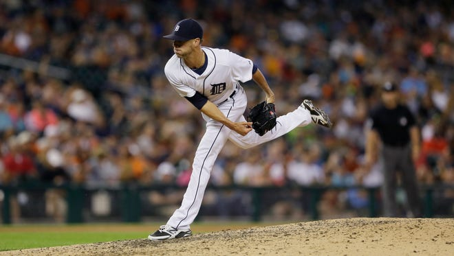 Detroit Tigers pitcher Shane Greene throws during the ninth inning of a baseball game against the Boston Red Sox, Friday, Aug. 7, 2015, in Detroit.