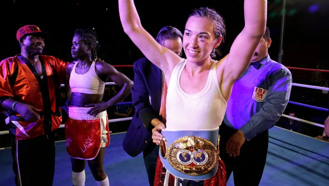 Jennifer Han raises her hands after winning the new IBF Featherweight World Championship last year.