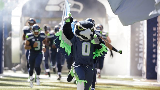 Blitz, the Seattle Seahawks mascot, leads the team out of the tunnel for an NFL football game against the Chicago Bears, Sunday, Sept. 27, 2015, in Seattle.