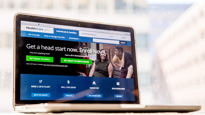 The HealthCare.gov website, where people can buy health insurance, is displayed on a laptop.