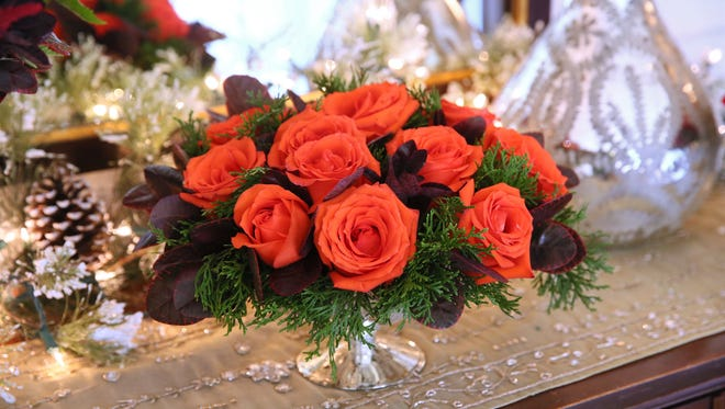 The Christmas arrangements created by Deb Fowler can be grouped on a buffet or server or used individually.