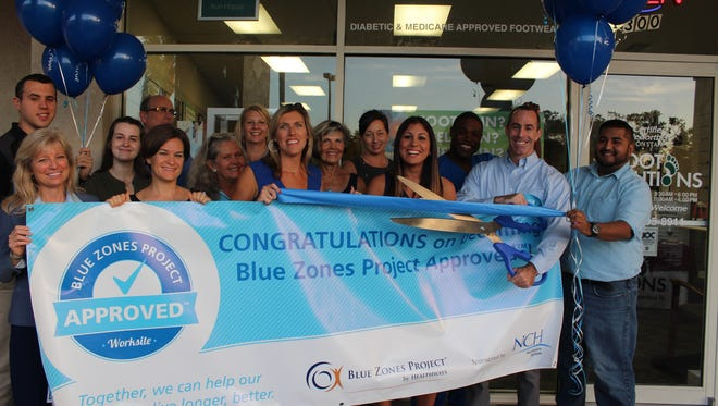 Foot Solutions employees and friends in Estero get recognized for adopting Blue Zones principles.