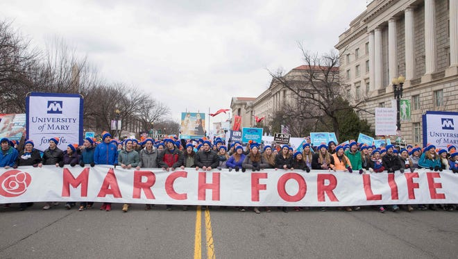 AFP_L55WJ.jpg Pro-life demonstrators march towards the US Supreme Court during the 44th annual March for Life in Washington, DC, on January 27, 2017. Anti-abortion advocates descended on the US capital on Friday for an annual march expected to draw the largest crowd in years, with the White House spotlighting the cause and throwing its weight behind the campaign.