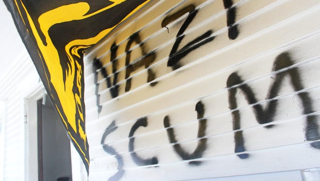 Residents at a house along N. Clinton Street covered graffiti on the front porch with an Iowa Hawkeyes banner. Photo taken on Jan. 27, 2017.