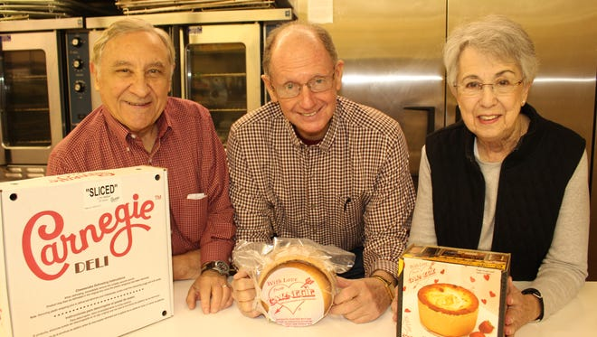 Bette Sue Strasburger, right, is joined by Lew Nyman, left, and Milt Livingston at Temple Beth Or where Cheesecake will be going fast at Sunday's annual Jewish Food Festival.