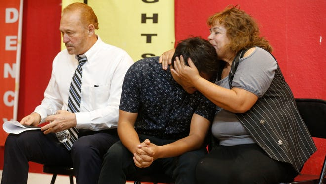 El Paso attorney Carlos Spector, who is representing Jesús Vasquez, center, sits with Vasquez and Vasquez's mother, Maria Maturino, as the two share a moment before the start of a news conference to give an update on Vasquez's legal status and the 12 days he was detained after being arrested following a routine traffic stop. Vasquez was stopped by a Texas Department of Public Safety trooper in the Montana Vista area in far East El Paso. Vasquez and his attorney plan to file a civil rights lawsuit.