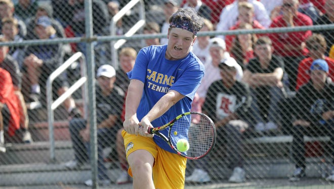 FILE – Patrick Fletchall, the defending individual state champ, helped lead Carmel past North Central on Friday.