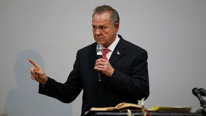 Former Alabama Chief Justice and U.S. Senate candidate Roy Moore speaks at a revival, Tuesday, Nov. 14, 2017, in Jackson, Ala.