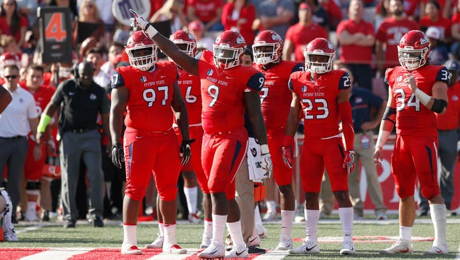 Fresno State linebacker Jeffrey Allison (9) and his teammates celebrate after making a fourth-down stop Saturday in a win over visiting Boise State. The two teams meet again this Saturday in the Mountain West Championship game in Boise, Idaho.