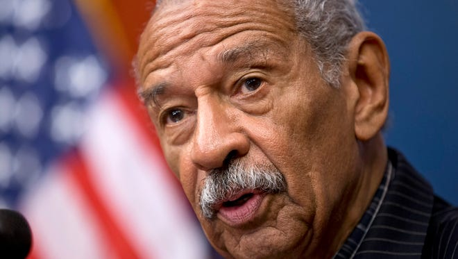 U.S. Rep. John Conyers, D-Detroit, speaks at a news conference on Capitol Hill in Washington onJuly 30, 2013.