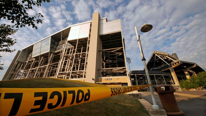 Police tape surrounds the site outside Beaver Stadium on July 23, 2012, where the statue of former Penn State football coach Joe Paterno was removed a day earlier.