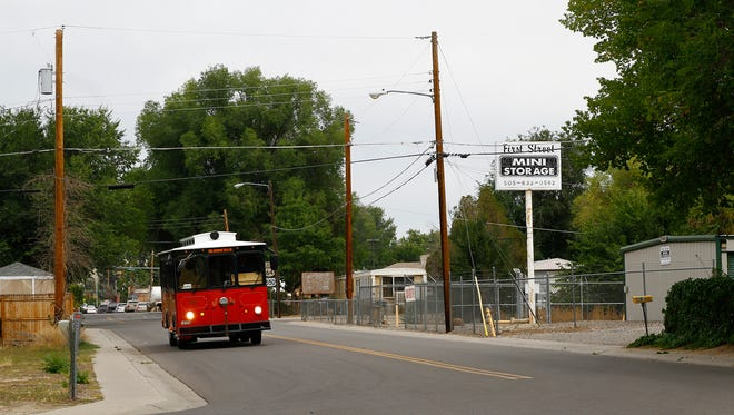 A Red Apple Transit bus droves down South First Street in Bloomfield on Tuesday. Beginning Oct. 1, the Red Apple Transit route that transports passengers between Farmington and Bloomfield will no longer operate.