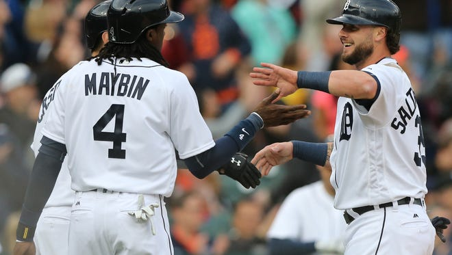 Tigers third baseman Nick Castellanos, centerfielder Cameron Maybin and catcher Jarrod Saltalamacchia score on a three-run double by shortstop Jose Iglesias Monday at Comerica Park.