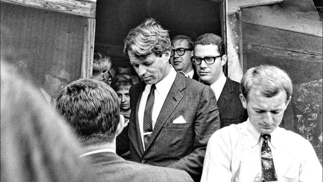 U.S. Sen. Robert Kennedy visits the Freedom City cooperative farm near Greenville, Miss., during a 1967 trip with members of the Delta Ministry's Freedom City operation. Kennedy was in Mississippi for U.S. Senate hearings on poverty.