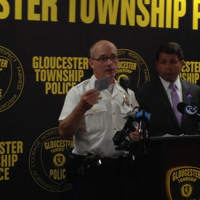 Gloucester Township Police Chief Harry Earle holds