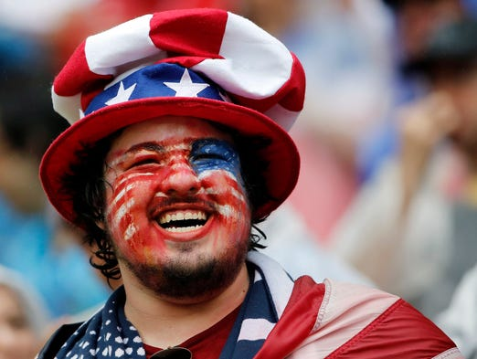 A United States fan is all smiles during the second half of Germany's 1-0 win at Arena Pernambuco. USA advanced to the knockout round.
