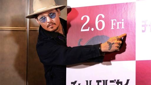 """U.S. actor Johnny Depp poses for photographers during a photo session prior to a press conference to promote his latest film """"Mortdecai"""" in Tokyo, Wednesday."""