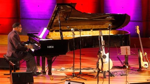 """In this file photo, jazz musician Herbert Jeffrey """"Herbie"""" Hancock, performs as part of Unesco Headquarters' in Paris Live Sets', during a ceremonial launch of the World Heritage Convention's 40th anniversary year. Jazz musicians from around the world will gather in April 2015 in Paris for International Jazz Day, an event UNESCO Goodwill Ambassador Hancock hopes will bring an uplifting """"positive message"""" to a city still reeling from last month's terrorist attacks. Hancock and UNESCO Director-General Irina Bokova announced Wednesday that Paris had been selected to be the global host city for the fourth annual International Jazz Day on April 30."""