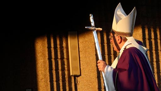 Pope Francis holds a pastoral staff as he arrives to celebrate a Mass in Santa Maria Madre del Redentore parish church on the outskirts of Rome, Sunday, March 8, 2015. (AP Photo/Riccardo De Luca)