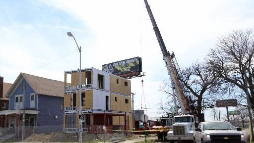 A company called Three Squared is building a model residential project in the Corktown district using empty shipping containers.