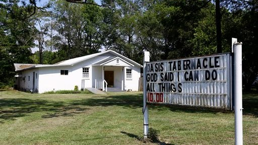 The Oasis Tabernacle Church is seen in East Selma, Ala., on Sunday, Sept. 20, 2015. Dallas County District Attorney Michael Jackson says suspect James Minter has been charged with three counts of attempted murder after allegedly shooting a woman, an infant and a pastor inside the church.