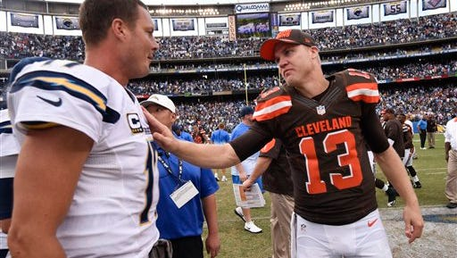 San Diego Chargers quarterback Philip Rivers (17), left, greets Cleveland Browns quarterback Josh McCown (13) after an NFL football game Sunday, October 4, 2015 in San Diego.  (AP Photo/Denis Poroy)