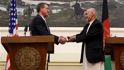 U.S. Secretary of Defense Ash Carter, left, shakes hands with Afghan President Ashraf Ghani, following a press conference at the Presidential Palace in Kabul, Afghanistan, Tuesday, July 12, 2016.